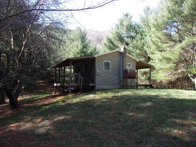 Bold creek.  Big timber.  Long range views from the top of the mountain.  Cabin with well, septic and power.  Very secluded and has State road frontage.  Cabin sets back off the road.
