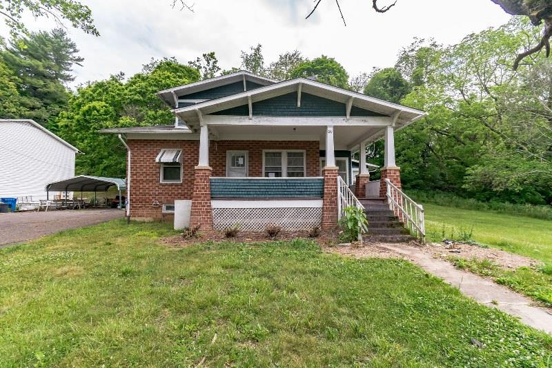 An inviting front porch welcomes you and your guests to this three bedroom, two bath home. Interior features include some hardwood flooring and a wood burning stove. Situated on over an acre. Whether you decide to customize this home for yourself or rent it out, this house could be a great option.