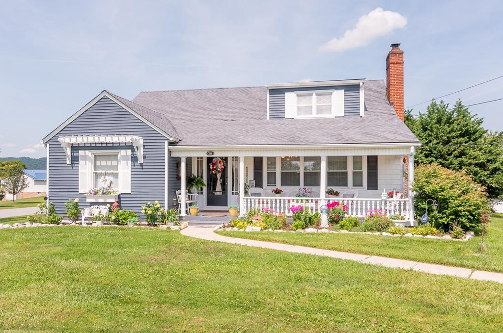 Immaculate Cape Cod located on a corner lot just minutes from downtown! Every room has been touched in this home including fresh paint, crown molding, wainscoting, pine tongue and groove ceilings and much more. The inviting floor plan provides plenty of space to entertain. New gas logs in the family room, well cared for HW and tile floors on the main, updated bathroom, and replacement windows throughout. Extra storage in the full unfinished basement. Take in the beautiful landscaping on the front porch or enjoy the gorgeous mountain views on the new back deck. This one is truly a must see!