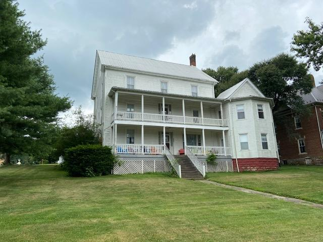With 15 bedrooms and 3 baths, this historical property has the potential to be anything your heart desires from a hotel to a family residence to multi family living.  Once the Hotel Sprinkle , this property still retains the character and charm of the 19th century. Home has large rooms with lots of chair railing and 2 covered porches for your entertaining and relaxing. With beautiful mountain views and situated on a lot that goes from street to street in Rural Retreat you won't want to miss out on this opportunity.There are plans already drawn for a Bed and Breakfast and Extended Stay development. Addendum: Some construction ha
