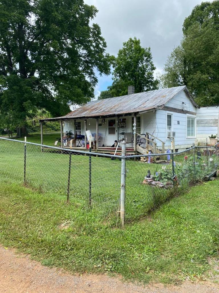 This 3 bedroom one bath home is currently an investment property with great tenants but the owner is out of the area.  The property does set on two lots and is flat.