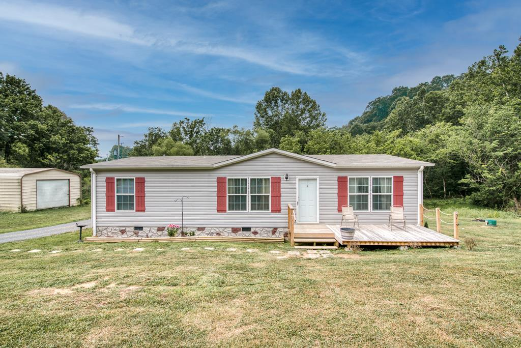 Just like new! This home is located on a 1.1 acre lot out in the country but is also just 10 minutes away from town. It was built in 2018 and is in move-in ready condition. The home features and open concept floor plan with a large kitchen and living room. Other features include a built in entertainment stand and built in shelving. You can enjoy the outdoors out on the front deck or out in the big back yard. The property also has a pond as well as a newer storage shed. The only thing left for you to do is move in! Hurry, this one wont last long!