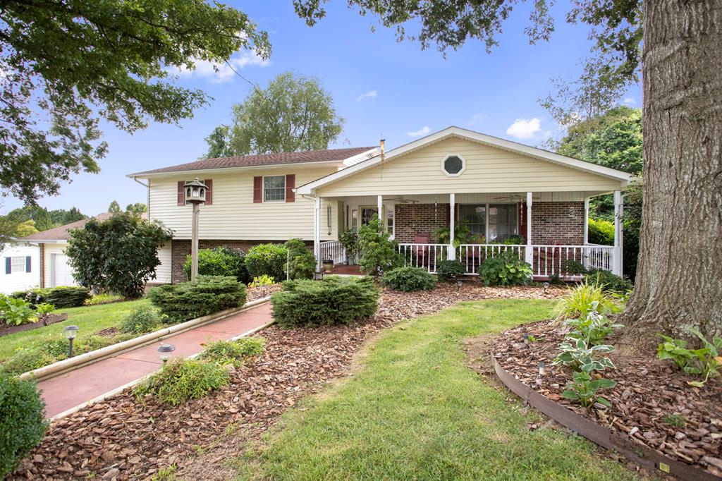This large, well-maintained home features tons of space and is conveniently located in the Westwood neighborhood of Abingdon!  Features include beautiful hardwoods and crown moulding, a large kitchen, dining room, living room plus a bonus den area with gas fireplace and another bonus recreation room!  Enjoy your morning coffee on the large covered front porch overlooking the well-landscaped lawn and excellent shade with the mature pin oak trees.  Enjoy the multi-level, spacious rear deck - with access from both master bedroom and kitchen. The large kitchen, deck and great backyard make this home great for entertaining.  Three bedrooms located on upper level with two full baths.  Lower level features the bonus den, full bath and large bedroom - potential for use as a separate living area.  Attached garage with entry into the lower level. The outbuilding in the driveway does not convey and is on site temporarily.  Easy to maintain vinyl siding and brick.  Make your appointment today!