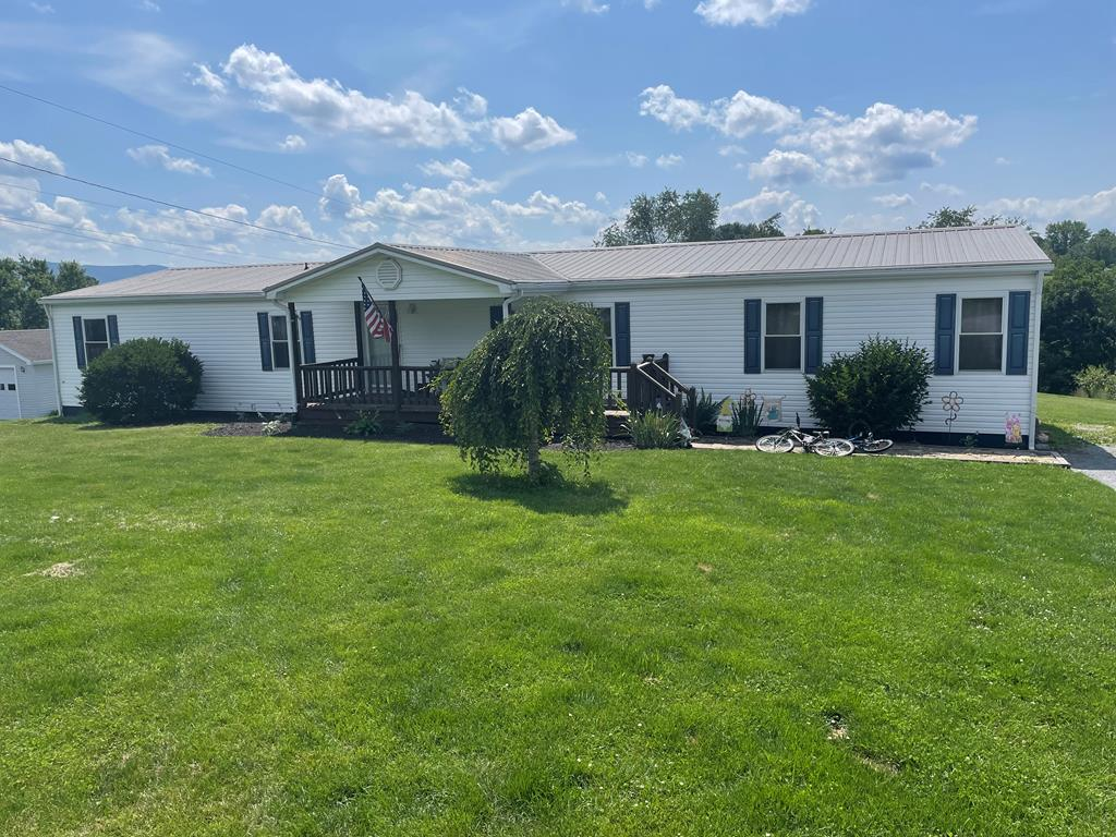 Beautiful 4 bedroom 2 bath doublewide located in the town of Rural Retreat. This home has numerous updates and upgrades including laminate flooring, waterproof vinyl tile, and custom tile showers. With spacious rooms, multiple living room/Den options, and a near 3/4 acre yard, there's plenty of room for the family.