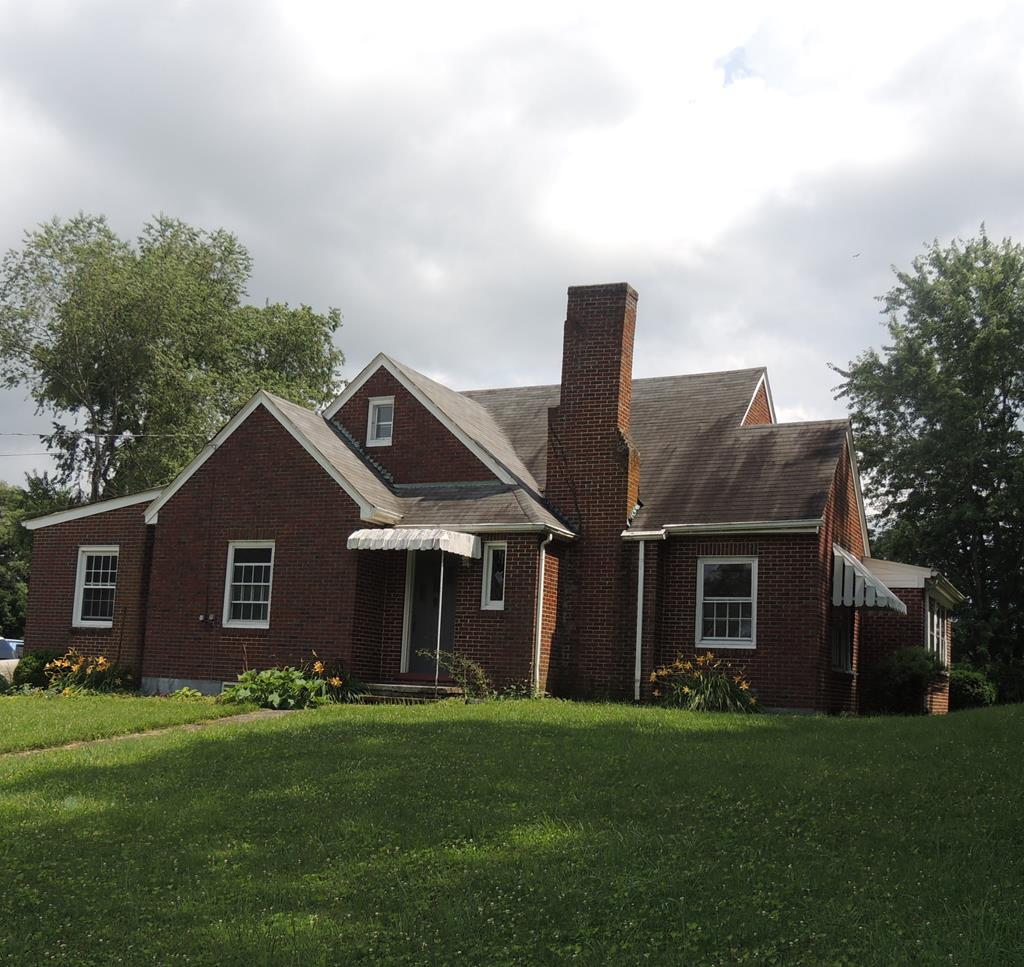 RARE FIND IN TOWN!!!! Excellent location with almost 2 acres in the town of Independence! Large house with plenty of area for entertaining guests or expanding your family. 4 bedrooms and 2 full baths, oversized kitchen with eat in breakfast area. Original hardwood flooring throughout most of the home. Many amenities are nearby, schools, shopping, eateries and medical facilities. Just a short drive to the New River and New River Trail, enjoy fishing, hiking swimming or canoeing. One acre is fenced with a barn that has a loft. Bring the horses. The garage has an upstairs that can be used for storage with an outside entrance. This area offers a wide array of outdoor activities hiking ,biking, camping and fishing. All within a short drive of the home. Nice, large front yard. Call today for your private showing!!!!!