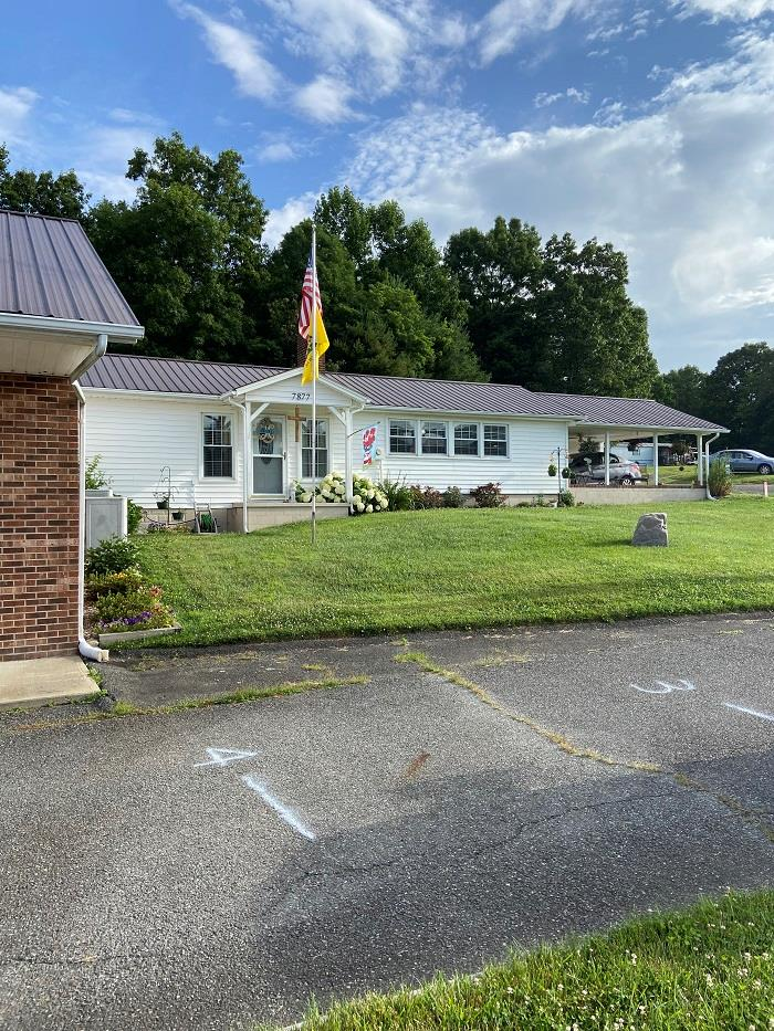 Opportunity! This property has potential to be a great business with different ventures to choose from. This is a brick ranch style building that once was a convenient store and has a 2 bedroom 1 bath home attached. Would make a great place to start your own business and have a place to stay while running it!  It would also be a prime building for apartments.