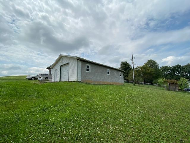 Here is your chance to own a property on Rt 11 that already has a garage/workshop in place.  Property has a garage and walk-in door to the main part.  The back is a workshop area with a walk-in door only.  Great view and would also make a great home site. Electricity is in the building but no heat,well or septic is on the property.