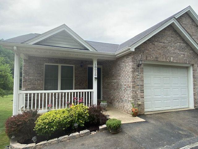 Great location just outside of the town limits. Enjoy the easy maintenance of this brick town house. Primary bedroom, full bath, half bath, open kitchen, dining room, spacious living room on the main level. The lower level will amaze you with 2 bedrooms, full bath, family room, exercise room & laundry hook ups; there is also a laundry hookup n the main level. All the kitchen appliances were purchased in 2017. Enjoy the view of the private back yard from the upper deck or the lower deck. Current owner says flood insurance is not required. You will enjoy the quiet, peaceful setting. Living near town with a country feel.