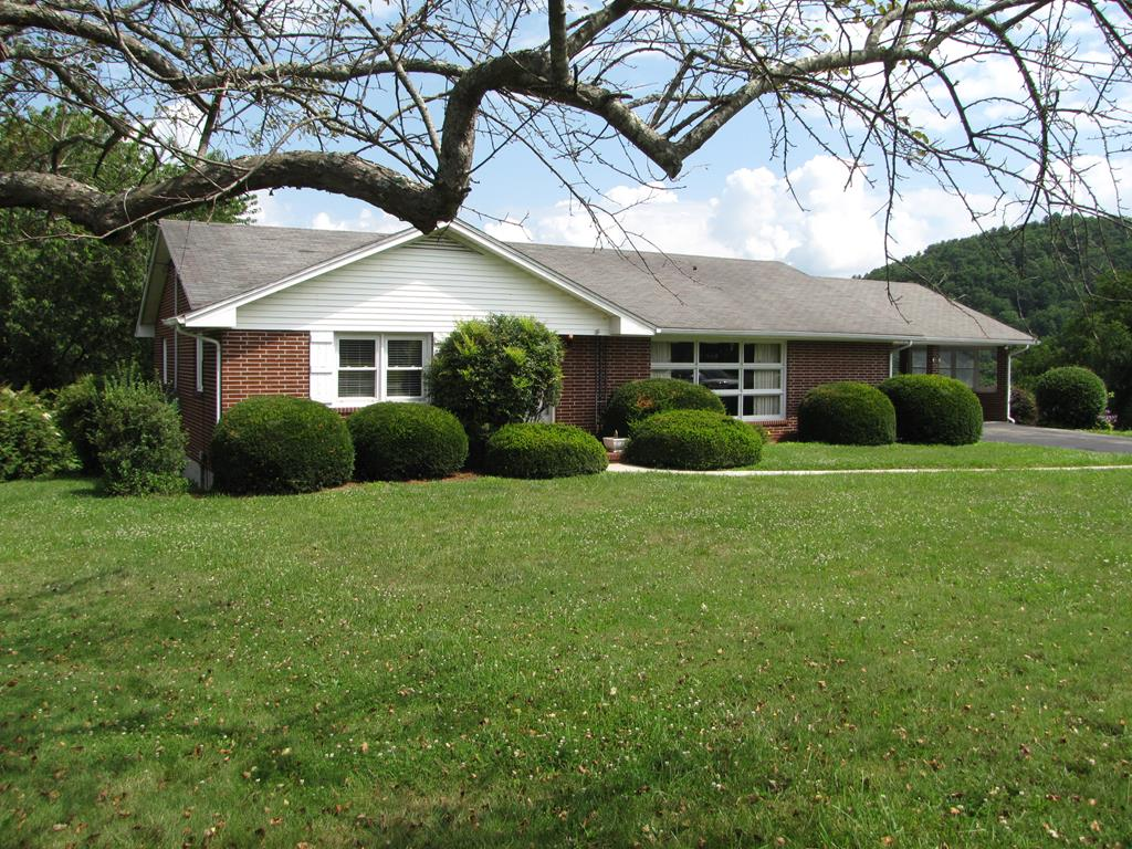 Nice brick ranch in great condition on 1 +/- acres.  The home offers a new heat pump in 2015, replacement windows in 2015.  The home has pine flooring in the living room, hallway, and both bedrooms under the carpet.. Brick fireplace in the den. The basement is painted, heated, and cooled. and a walkout.   1/2 bath, old cookstove, and sink for a summer kitchen , and a 200 amp breaker box in the basement.    All appliances in basement convey.  The owner does not warranty any appliances as the home has been rented.