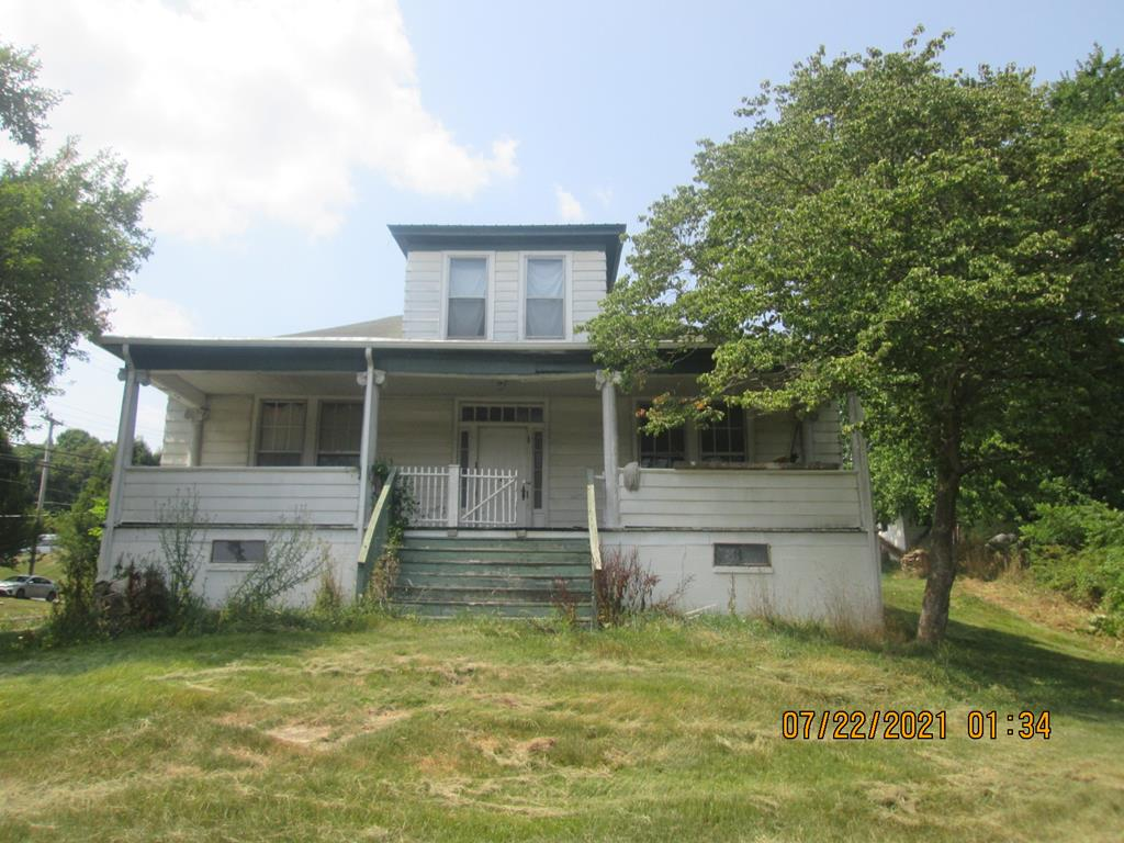 Larger home with lots of possibilities. Possible rental units/duplex. Two kitchens in place. In town location. Hydronic heat has been disconnected. Home is in need of some TLC inside and out. Being sold AS-IS, where is.  Deeded 15' right of way off Louisa.