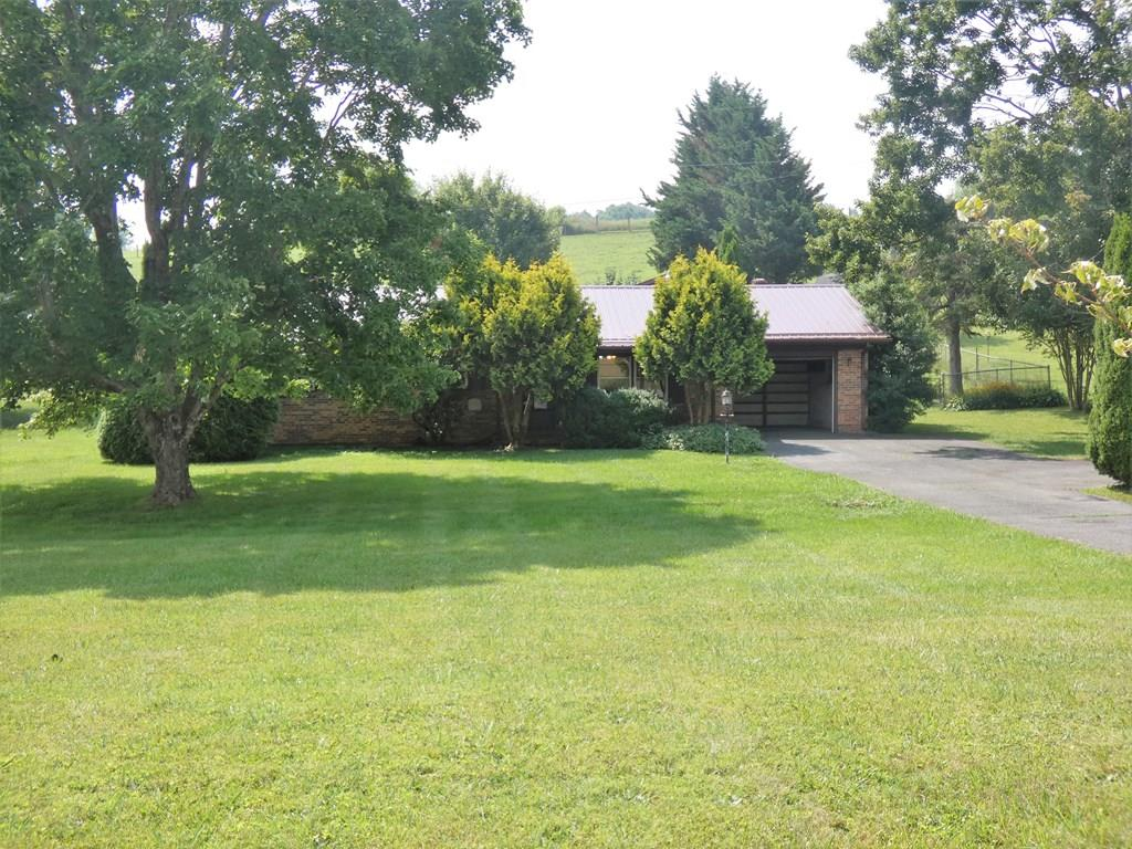 Two properties for the price of one! This home is a one level four bedroom/2 full bath brick ranch built in 1995 sitting on a beautiful quiet, county setting  of almost 2 acres with mature trees and a chain linked fenced back yard. So many possibilities with these properties! Also included is another one level vinyl sided building (900 square feet) which previously been used as a commercial garage. It has electricity, heat, water, and a bathroom. It could easily be converted into another home or a business! It is ready to be framed inside any way you want it! This property needs the right person to get these dwellings back in good condition. Be close to camping and hiking at the Jefferson National Forest, Grayson Highlands State Park, the Hurricane Campground, and the Appalachian Trail! Plenty of room to park your RV, boat, and all your toys!