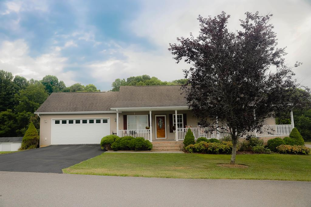 REDUCED--Come See this Custom Built Home in sought after Chilhowie School District before it's Gone! This Loved One Owner 3-BR 3-BA home offers a master on main with a walk-in shower, a jetted soaker tub, and dual sink vanity. Bedroom two located on main, opens into the second bath. Bedroom three a second master/family room/or inlaw suite and third bath is located on the lower level which offers lots of closet space/storage/and a 1 car drive under garage/storage/or workshop. The living room has beautiful hardwood floors, gas log fireplace and is open to the dining room where you can walk out onto a large deck to enjoy your morning coffee and grill a steak for dinner. The dining room is open to the kitchen which offers lots of wood cabinetry, tile floors, all white appliances, a large island, and beautiful silestone countertops which is stated to be the world leader in all types of mineral surfaces and countertops for kitchens and baths and never needs sealing, it can be cut on.