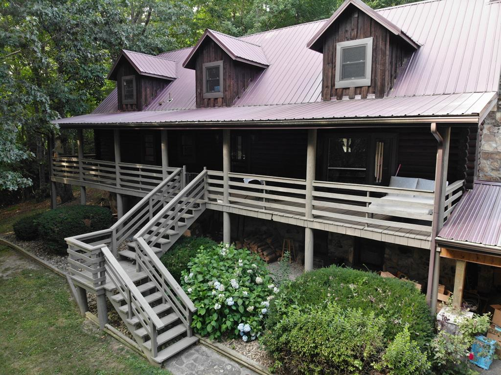 Private, secluded 3 BR, 3 BA Log Cabin located in the mountains of VA less than 5 minutes from I-81. Rustic chic. A prepper's dream. New updates include new flooring. Homestead of 36 acres with fencing. Barns, equipment sheds.  Hugelkultur raised beds in fenced garden. Mature hazelnut trees, peach, pear trees, blackberries, red raspberries and more. Hardwood trees - oak, hickory, sourwood, cherry, walnut. Some cleared land and some forest. High speed internet. Security cameras. Paved driveway and new carport with stonework on columns. House has new windows and doors. Kitchen features custom cabinets, large butcher block top island, copper sink, two ovens. New master bath with heated floor. New hardwood in living room. Mini-splits heat/cool efficiently. New back porch. Fresh paint inside and out. Plenty of storage in carports and out buildings. Solar panels. Generator will run the whole house for a month on the in-ground propane tank. Breathtaking views from hilltop pavilion.