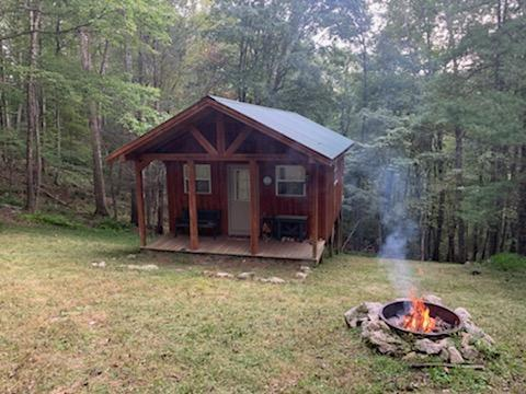 Here's your chance to own 78 acres in beautiful Grayson County in Fox Creek community.   This property offers a nice build site at the bottom of the mountain with great views.  For now, you can enjoy the cabin on the weekends and enjoy being off the grid for break.   Trails intertwined throughout the mountain make for fun recreation and access to deer stands and the top of the mountain where there are some wonderful views!