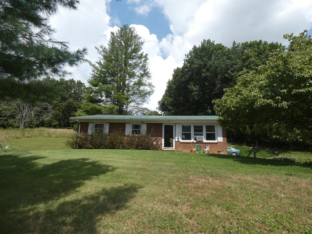 Nice brick ranch in the country with walkout basement. This home features 3 bedrooms and 1 bath. It has newer flooring, newer metal roof, and is sitting on 4.72 acres with plenty of beautiful mountain views. This home provides the perfect escape from a busy life to just sit on the back porch and enjoy nature. Schedule your appointment to view before this one gets gone!!