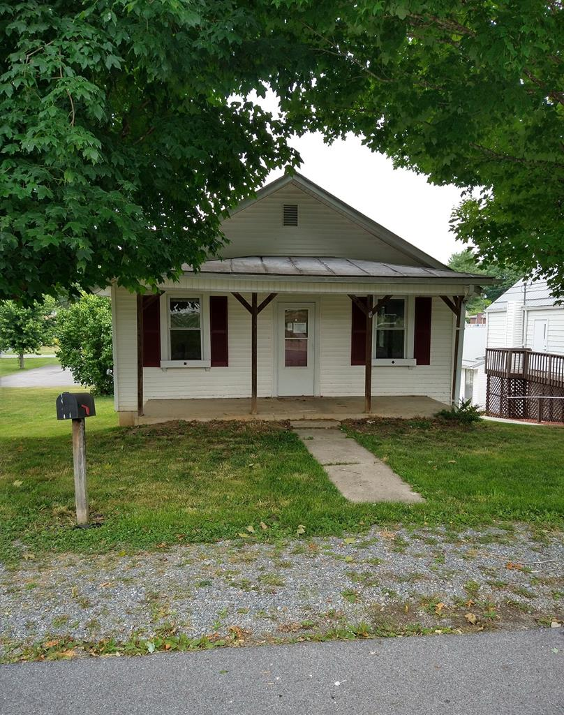 Great smaller home in town of Marion. Close to everything (shopping, grocery, medical, etc).  Would make a great starter home or the investor looking to bring this home back to it's original charm. Great price and potential awaits the new owner! Home being sold as-is/ where-is.
