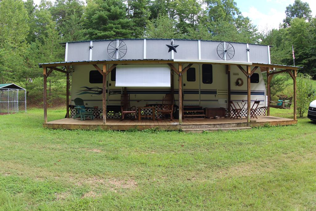 """RV Camper (8'X 32') with slide out (3' x 12'6""""). Approximately, 294 Sq Ft. Main Floor: Dining Room, Living Room, Kitchen combo. Bedroom (Queen Size Bed) and Full Bath. Front porch (8' x 32'). Private Well and Septic. Land is rolling. Stream. Very Private. Underground power lines. Telephone is available. Great for Week-End Get-A-Way or Vacation. 15 minutes to Fairystone State Park and Philpott Lake. Provides Lake access with boat dock - fishing. Also, plenty of Land owned by the state of Virginia for hunting. Which would require you to get a hunting permit. Come to Patrick County and Enjoy County Living at its best."""