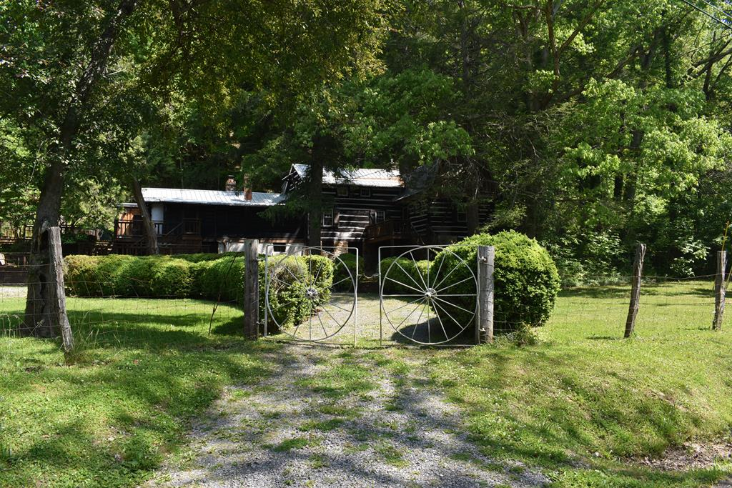 ENJOY your own  272 acres of Mountain Paradise in the beautiful majestic mountains of Bland Co.in this modernly updated Log Home.  Portions of the main house is over 100 years old with unique features such as hand hewn logs  from this mountain with the broad axe markings and dovetail joints    Two updates completed in 1960's and 1990's. Enjoy hiking, hunting, canoeing, kayaking, fishing from the trout stocked creek or your private pond or making your personal ATV trails.  Have your own Mountain Retreat within minuets of I-77. This property includes a high efficiency propane furnace and a water purification system. New metal roof 2 years old insolated replacement windows.