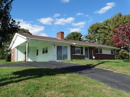 Great location between Hillsville and Galax. Home features: 3 BR, 2 BA, 1752 sq. ft., Living room features a gas log fireplace, Family room has a wood burning fireplace, Kitchen has a nice size pantry and plenty of cabinets. You can walk out to the 8' x 12' open deck. Laundry room on main level, Hardwood floors under carpet. Replacement windows, Alarm system, New roof being added 8/30, Newer plumbing, Basement, 9' x 11' Utility room, Paved driveway with 2 entrances, Large level lot. There is a nice level area for a garden. Home is low maintenance with vinyl trim. Public water