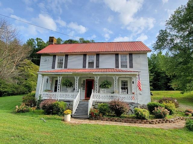 Historic Charmer! Beautiful 3 bedroom 2 bath Farm House dates back to 1900 and sitauted on 25+/- acres in the Blue Ridge Mountains of Southwest Va. Spacious home for a growing family or very attractive bed and breakfast. Features include: large living room with rock fireplace, hardwood flooring, kitchen/dinnig area & appliances convey, master bedroom, bath and laundry on main level, Upstairs you have 2-large bedrooms, full bath and sunroom. There are no neighbors in sight! Gorgeous land with approximately 1450 ft of creek frontage on Meadow Creek, also enjoy looking over  2-ponds form the covered front porch. Land is plentiful with trophy size wildlife. Located within a short walk to the New River. You don't come across properties like this every day, and it's just waiting for the right new owner who can appreciate all the unique character and charm this place has to offer,