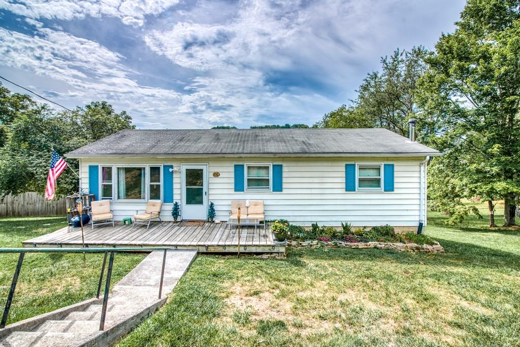 This Cozy home is perfect for a first-time homebuyer or an investor looking to purchase a property with an established tenant! The welcoming layout offers 3 Bedrooms and 1 Bath over a full basement. Tucked away right outside the town of Marion, but with close access to Chatham Park and the Town pool, this home features a large backyard that comes equipped with a shed. The spacious unfinished basement has a chimney for a wood stove, you'll just need to pick out the wood stove of your dreams! The overhead door in the basement provides great access to a perfect spot for a workshop and storing outdoor equipment.