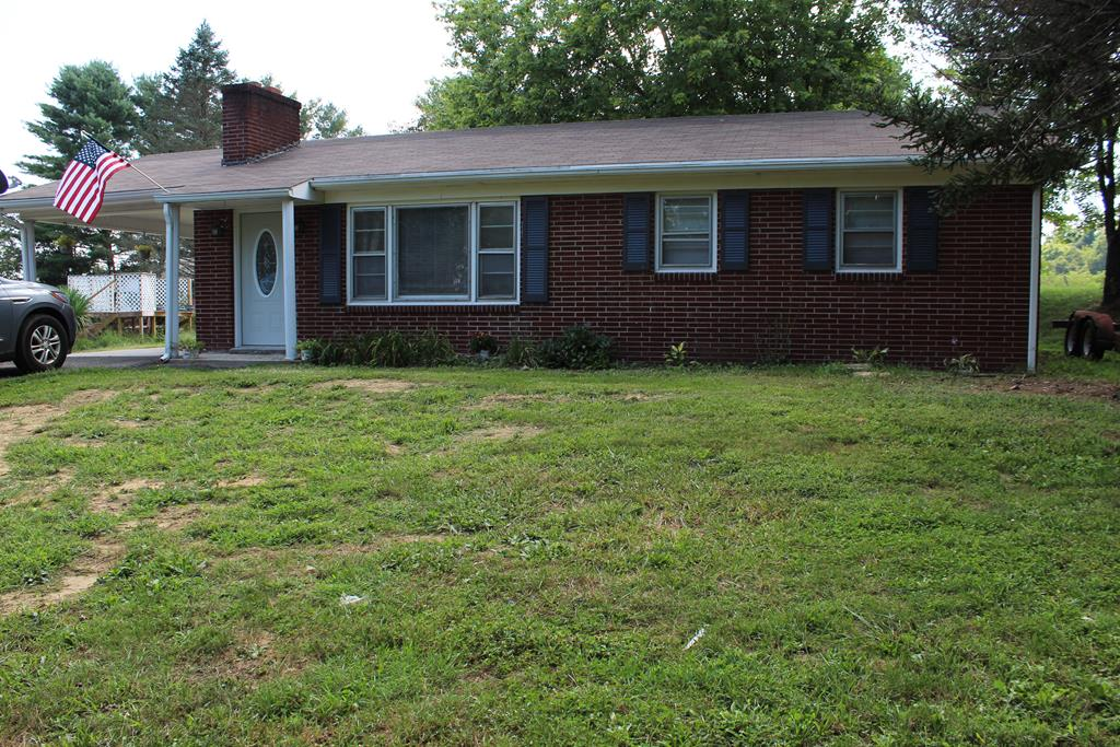 Move in ready, totally remodeled interior. 2 bedroom, 1 bath brick ranch outside of the Town of Fries, within 10 minutes to Galax, 20 minutes to Wytheville.  Beautiful corner lot with mature shade trees, including towering chestnut trees.  Fresh paint through out,  new floor coverings, refinished hardwood floors in living room and hallway.  Remodeled bathroom with tile tub surround, vanity, and fixtures.   The kitchen/dining room has also undergone a facelift, with new countertops, tile backsplash, flooring, fixtures, and a coffee bar station.  All new window and door moldings, new 6 panel doors, new front door, ceiling fans, and accent wall on either side of the fireplace.  Plumbing has been updated to pex water lines. New baseboard heaters and controls.  Outside you will find not 1 but 2 storage buildings.