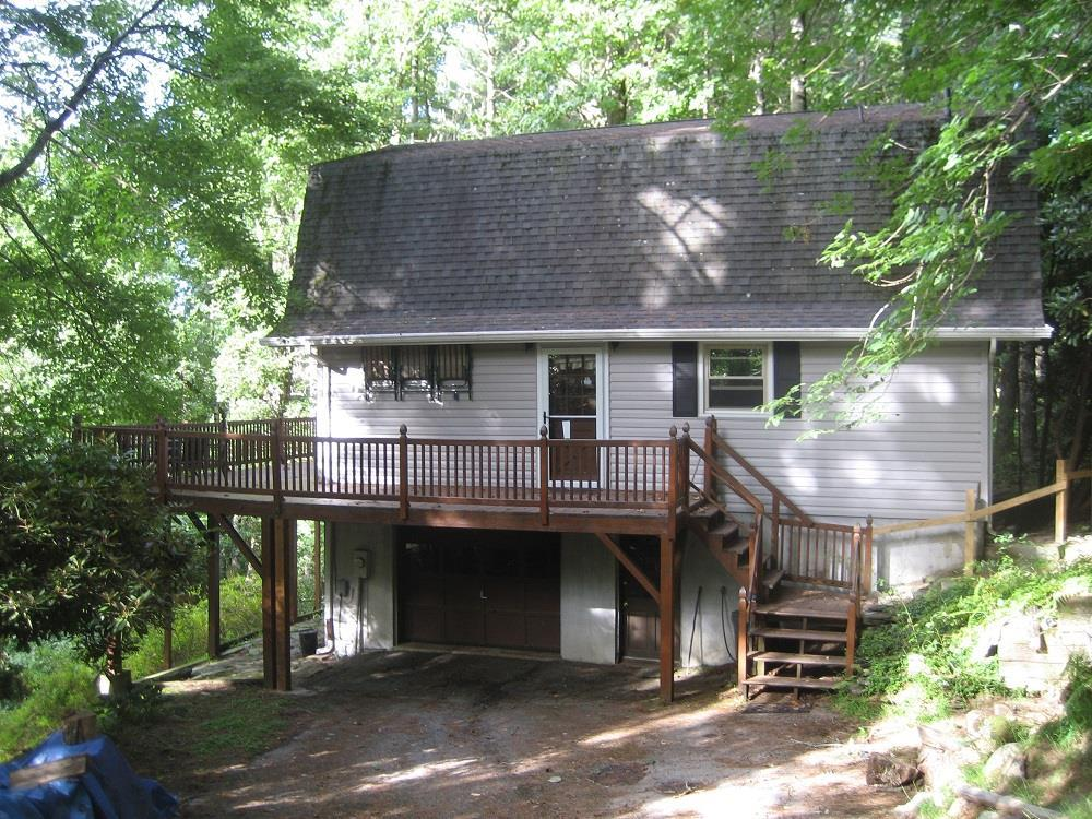 2 BD 2 BA mountain home right off the Blue Ridge Parkway at mile marker 174 in Meadows of Dan where it's always cooler than the neighboring cities. Very well maintained home with newer appliances, a Master bedroom and bath on the main level, and second bedroom and bath on the loft level along with large sitting area/office desk with great views. Main level also has the galley kitchen, and open living/dining area with wood floors, 2 story vaulted ceilings with large NEW windows and 2 sets of NEW sliding glass doors. The living area has a brick fireplace with gas logs. The chimney was recently relined and is cleaned annually. The lower level has a 1 car garage space, workshop area and laundry.  There is also a wood burning stove in the lower level that provides a secondary heat source for the entire house.  Other extras include clogless gutters, Radon evacuator vent, new toilets and plumbing, and dehumidifier.