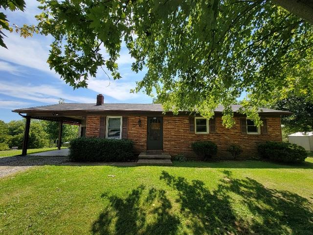 Great location in Galax City!  Brick Ranch Home with 3 bedrooms 1 bath, heat pump, propane stove, 1-car carport on a nice corner lot.