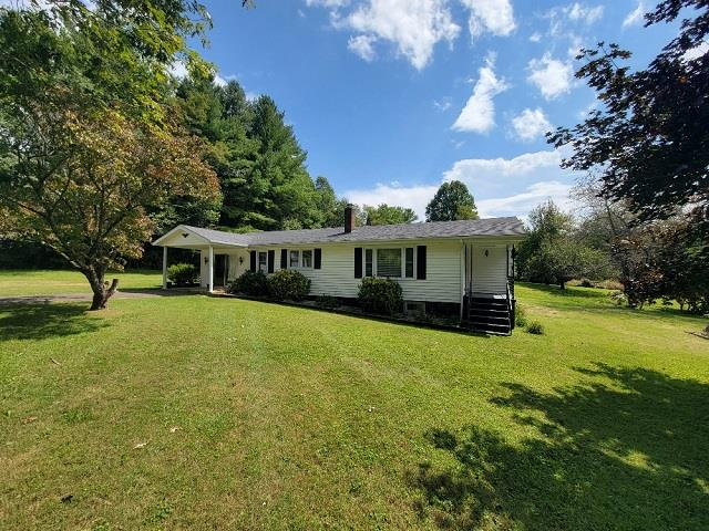 Vinyl sided home in the Pipers Gap Community! Features include 2 bedroom 1 bath with spacious living room & den, kitchen/dining area and appliances conevy, 2-oil monitors, propane gaslogs,  very nice detached garage with paved driveway and located in a quiet location.