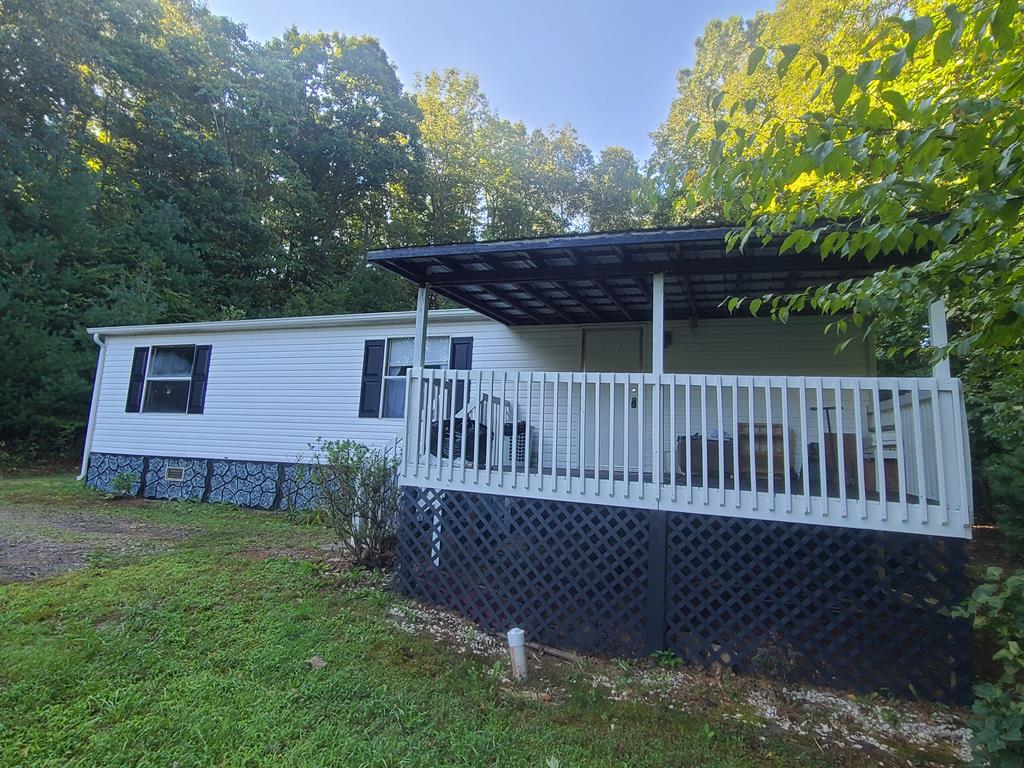 Great little property in a good location. This doublewide is in a private setting, with a row of trees out front that gives you a little privacy, but your only minutes from Galax, Mt Airy and many other attractions. Theres a covered front porch thats perfect for setting and taking in the sights and sounds of nature. As you walk inside you enter the mudroom/ laundry. Large open kitchen and living room. There are 3 nice sized bedrooms and 2 full bathrooms, i has been recently updated with a brand new walk in shower. Theres also a porch that leads out back. this is a great home for first time buyer, second home or a great weekend getaway.