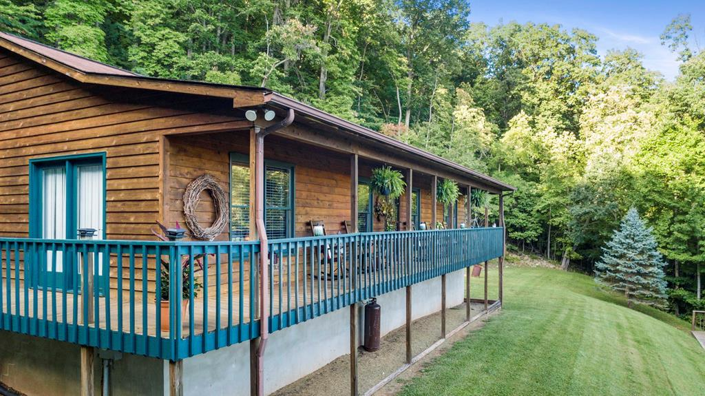 Check out this beautiful home in the mountains!! This little gem in nestled on Drapers Mountain in a private setting, in the heart of the New River Valley.  This sweet place is 3 short minutes to I-81 for you commuters who want to be close to everything yet private as well.  Just imagine sitting on your front porch every morning watching the sun rise over the trees as you drink your coffee. This place is BEAUTIFUL!  The location is perfect!! This listing could also be a hunters paradise as well with over 4 acres of wooded property loaded with wildlife for you to enjoy. The owner has replaced all the flooring with beautiful laminate, new appliances and the taste she has is pure perfection in everyway! This home has been well loved. With a paved drive,  3 bedrooms, 2 full baths, full basement as well as an entertainment deck in the front yard for company, what more could you ask for? Call and schedule your showing today, this listing won't last long.