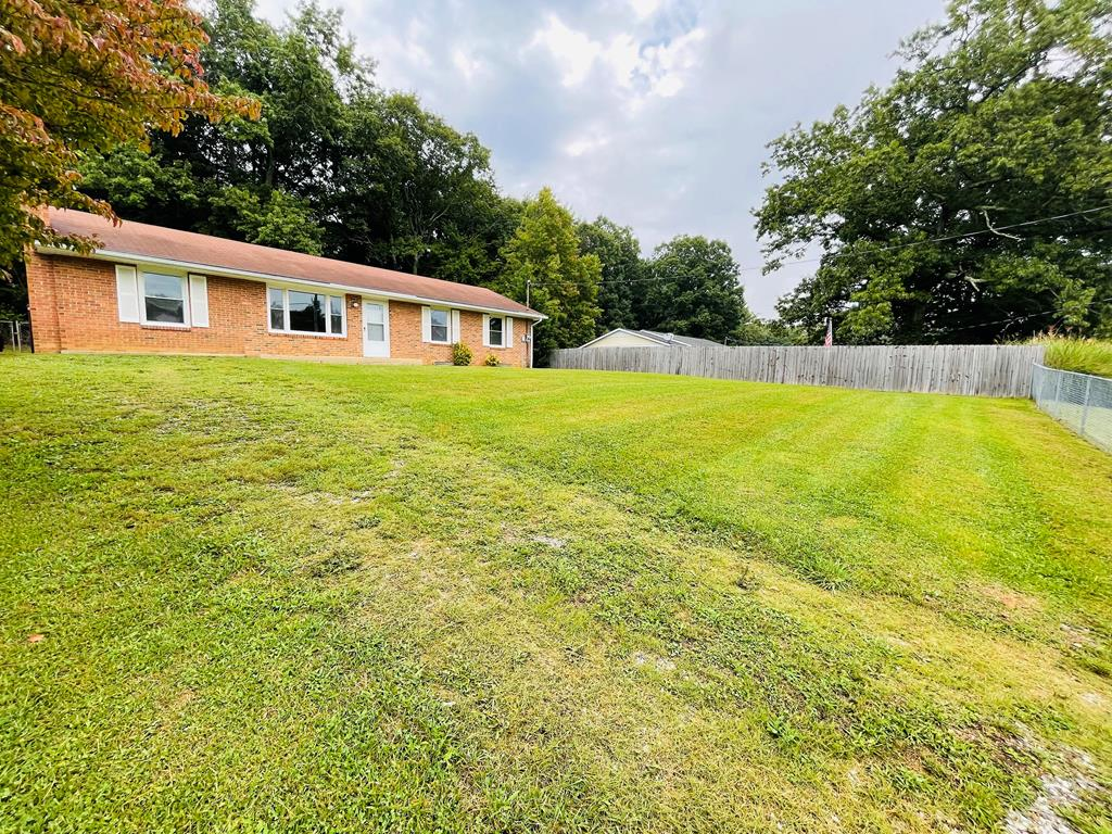 Check this one out! Nice 3 bed 1 bath ranch style home conveniently located off of Route 100 in Hillsville! This property features a fenced-in back yard, partially fenced front yard, covered stone patio, newer fixtures, some kitchen appliances, hardwood and laminate flooring, and a den that could also be used as a 4th bedroom!