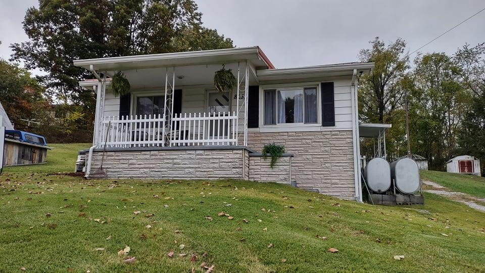 Looking for a home suitable for Multi family? This 2BR, 1 BA home has a detached garage/shed with upper storage or could be made into a small apartment space.  There is also another septic on the property that was put in last year approved for 2 BR (up to 4 occupants).  It is ready for a modular, mobile home, or tiny home.  This property has two tax maps and two separate addresses ( 815 & 823). There is a driveway with right of way to this property. So build your own home and rent out the existing.  Lots of possibilities.  All of this on approximately 1.62+/- acres.