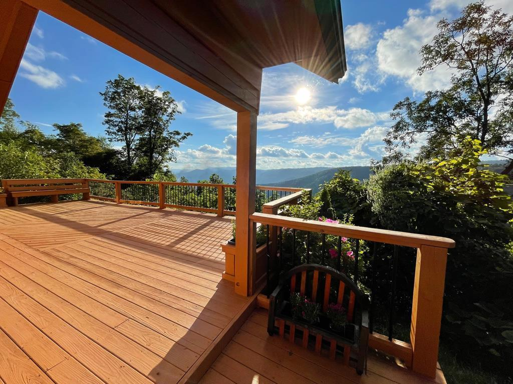 Beautiful sunsets looking over the Blue Ridge Mtns. right off the Blue Ridge Parkway in Fancy Gap. Cabin features: Log construction with a metal roof, spacious deck with awesome views.1184 sq. ft., 2 bedrooms, 2 baths, mini split heat pump and wood stove. Located in Crystal Springs Subdivision.