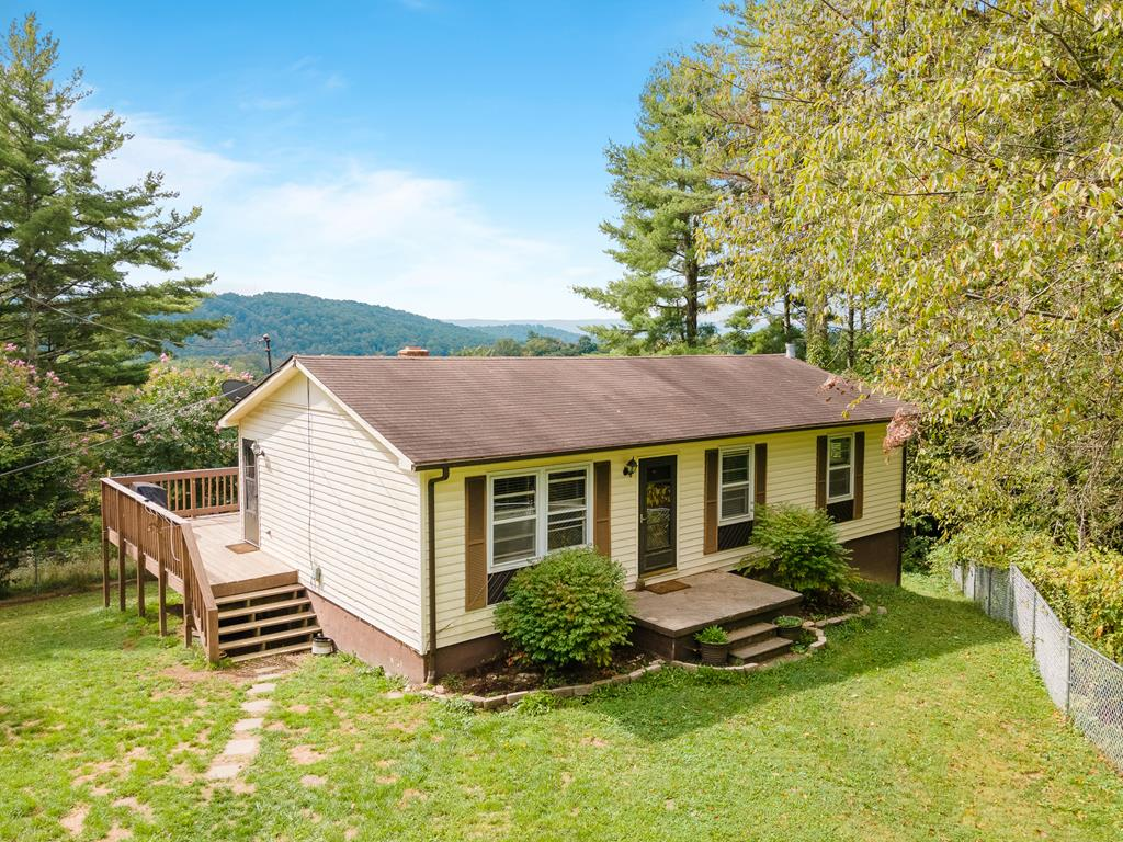 3 BR 1.5 BA ranch home on about a half acre in Bland, VA. Large rear deck, outbuilding for storage, gravel driveway, and the whole yard is fenced, great for young ones and pets. Home has been partially renovated including new kitchen cabinets, countertops, appliances, and absolutely beautiful new wood flooring! All three bedrooms on the main level, as is the full and half bath. Downstairs you'll find a pellet stove to keep the house extra cozy, the laundry room, an extra living area or play area for kids, and even another large room that'd be great as a 4th BR, as it is currently used. Public water and its own septic. A lot of finished square feet for the money!