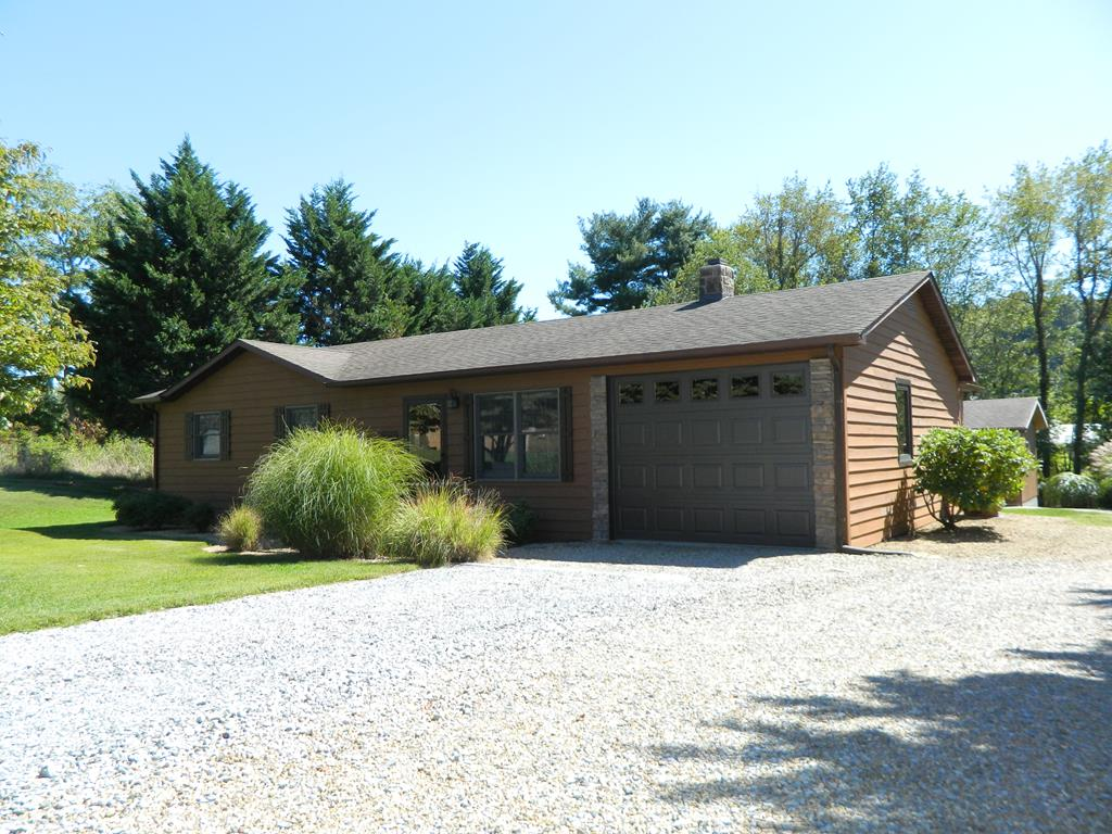 """View this beautiful custom home with quality workmanship located in the Chilhowie School District and just minutes to US Hwy 11 and I-81. Immaculate inside & out, offering enlarged master bedroom, hall bath with barn door, sunroom, second bath with shower and great room. Great room living area features barn wood walls, natural stone fireplace, vaulted ceiling, oak HW floors, beautiful wood stove - converted to gas - w/glass doors & thermostat controlled. Kitchen features custom oak cabinetry w/sliding shelves & drawers, like new Frigidaire Gallery refrigerator & range (convection oven) & still under warranty. Hall has barn wood wainscoting. EHP installed 2020, 100 gallon propane tank conveys. Sunroom features vaulted 6"""" tongue & groove wood ceiling, tile floors, propane plaque heater & walls of windows. Other features include custom shades, Andersen windows w/screens in all of house except sunroom, which is Peachtree, crown molding w/custom trimmed doors & windows. Smoke-free home."""