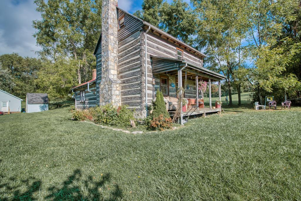 Beautiful 1800's log cabin with absolute tons of character. Home was built with a spoon axe, so every piece of lumber was hand carved and put into place. Hardwood floors and a large living room, this home is a perfect example of western living in the gorgeous Appalachian mountains! Home is located right next to all the schools and amenities of Rural Retreat. The cabin has a large kitchen area, and the upper bedroom is a loft. Log cabins in this condition are rare, so scheduling your showing today!!!
