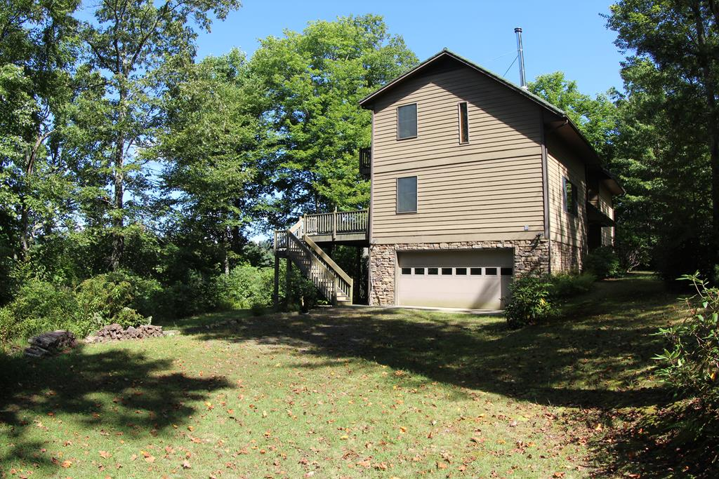 """Well built 1 1/2 Story Custom built home with 4 bedrooms - 3 baths in excellent condition located in Patrick County, VA (318 Ramp Hollow Road, Meadows of Dan, VA 24120). Approximately 2,648 sq ft finished.Secluded.Main Level: Foyer, Living room (12''6"""" x 23'9"""") dining room combo (10'6"""" x 12')""""), Kitchen (10'6"""" x 13'9""""), 2 bedrooms and full bath. Kitchen has custom made and custom painted cabinets - tile around stove, 2 bar stools at counter. Wood burning stove with brick on wall and floor where stove is in the Living room - hardwood floors ceiling fan and cathedral ceiling.French door from dining room to back deck (20'6"""" x 12'6""""). You can enjoy reading a book, entertainingor just enjoy nature at its best from the deck. Peaceful setting. Trex boards on deck and steps leading to backyard. Front porch (4' x 12'6"""")."""