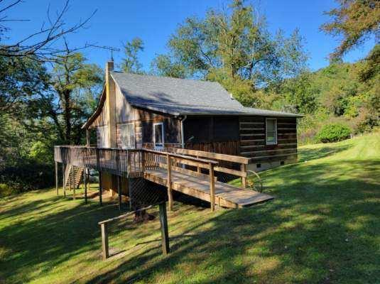 Take a look at this authentic cabin on 6.13 acres in Hidden Valley! Located just north of the Town of Independence in an established neighborhood, this 2 bed / 1 bath home has all the cabin style you could ask for. An open floor plan living, dining and kitchen area provide great space for entertaining and a vaulted ceiling provides openness while still feeling cozy. A large bedroom with closet next to a spacious bathroom are also on the main floor with a loft-style bedroom upstairs. Outdoor living spaces include a screen porch, wraparound deck and covered front porch. Mature trees create privacy and the property is located close to the community lake and picnic shelter. This home would make a great full-time residence or weekend getaway.