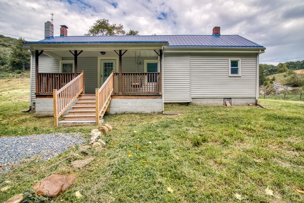 """Come check out this beautiful 3 bedroom 1 bath house in Marion! Spacious eat in kitchen with lots of updates including paint, back splash, cabinets, countertops, new stainless appliances, and flooring. Large living room with hardwood floors and built in shelving. Three spacious bedrooms and a remodeled full bathroom. Large laundry room with a sliding barn door entrance which includes the washer, dryer, and extra refrigerator. Front covered porch and large back deck. Lots of privacy and farm views! Schedule your showing today! *buyers/ buyers agent to verify all information"""""""