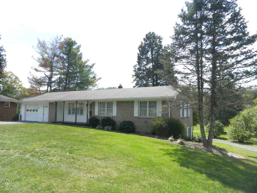 Location, Location, Location...convenient to I-81 (1.2 miles), Barter Theatre in Abingdon (30 miles), Bristol Raceway (45 miles). This great home, large enough for 2 families, boasts 2 levels of living. 3 BR, 2 BA on main level with Family Room, laundry, BR, BA & storage on the lower walk-out level. Lower level has a garage and upper level has a spacious carport. Recent updates include new heat pump (Trane) 4/2019, new roof & guttering 8/24/2010, red oak planked waterproof laminate w/25 year warranty 4/2003 & new refrigerator 4/2013. Great backyard with shade under a unique Dawn Redwood tree, concrete pad w/ramp for outbuilding, and nice views. Gas tank hook-up in back yard with line running into house. Gas stove heater in basement. New water meter & line from meter to house with frost free spigot in 2020. **Additional Sellers: Connie K. Sheets, Zandra S.Teaster & Karen J. Stewart.