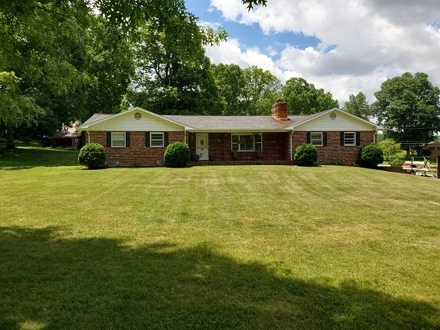 Prime Location! This 5 bedroom, 3 bath home is located in a great community, just off US-58 and close to I-77. This brick home is located on a spacious corner lot and features a large outdoor living space, finished basement with kitchen and would be great for mother-in-law suite, attached 2 car garage and has a newer heat pump but also has propane and a wood stove for back-up. The home has a new roof, underground dog fencing, new hot water heater, and fiber optics have been run to the house but not hooked up. House is hooked to county water but still has well if needed. Would make a perfect home for your growing family!
