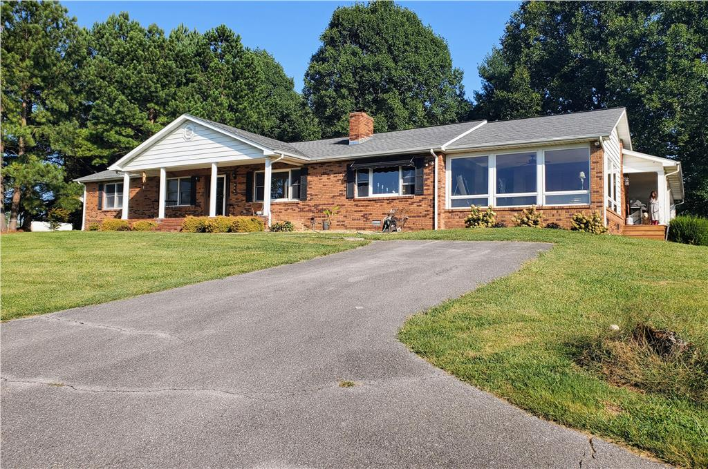 Ranch style brick home with covered parking carport and partially covered deck. This home is located on 5.86 lot with scenic view of mountains. Private wooded lot. Paved driveway.