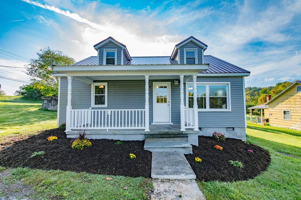 Take a look at this charming home built in 1950. The home has been completely renovated inside and out, but still has that old style charm as well. The original hardwood floors have been restored to their former beauty. The kitchen is all new, to include hickory cabinets and granite countertops. The 2 bathrooms have been renovated to have a modern flair, while still staying timeless in their design. The home has a new metal roof, new heat pump for central heat and air, and the laundry room has been redone and is conveniently located on the main level just off the kitchen. There are 2 bedrooms and 1 bath on the main level, and 3 bedrooms and 1 bath upstairs. This home is perfect for the large young family, with plenty of room to grow, with a modest budget. The back yard is beautiful and level. You have plenty of room for the kids and dogs. You are also extremely convenient to everything in Hillsville, not to mention just 8 minutes to the Blue ridge Parkway, and 4 minutes to I-77.