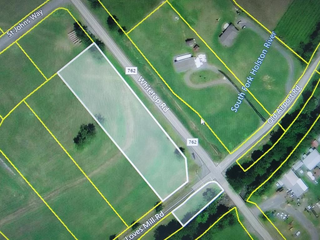 Beautiful home site in Smyth County's prestigious St. John's Crossing with newly built homes. Come build your dream home here!  These quiet lots are out in the country but are only minutes from Interstate 81. This lot is divided by the road and continues across the road on the river with river frontage and access. This lot has road frontage on Route 600 (Whitetop Road) and  Route 762. (Loves Mill Road) St. John's Crossing has underground utilities, paved streets and pastoral views of the mountains. These lots are located minutes from the base of the Iron Mountain, leading up into Whitetop, Mount Rogers and The Grayson Highlands Park Area, where bountiful fishing, hunting, hiking trails, camping and biking are year around treasures.