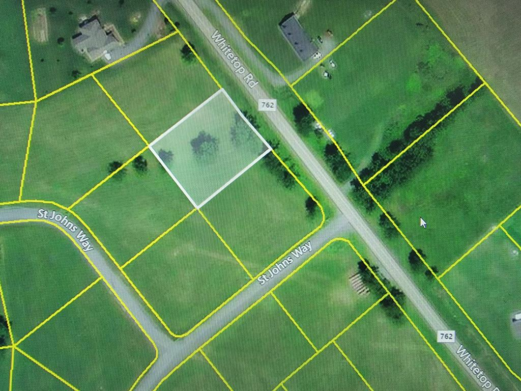 Beautiful home site in Smyth County's prestigious St. John's Crossing with newly built homes. Come build your dream home here!  These quiet lots are out in the country but are only minutes from Interstate 81.St. John's  Crossing  has underground utilities, paved streets, and pastoral views of the mountains. These lots are located minutes from the base of the Iron Mountain, leading up into Whitetop, Mount Rogers and The Grayson Highlands Park Area, where bountiful fishing, hunting, hiking trails, camping and biking are year around treasures.