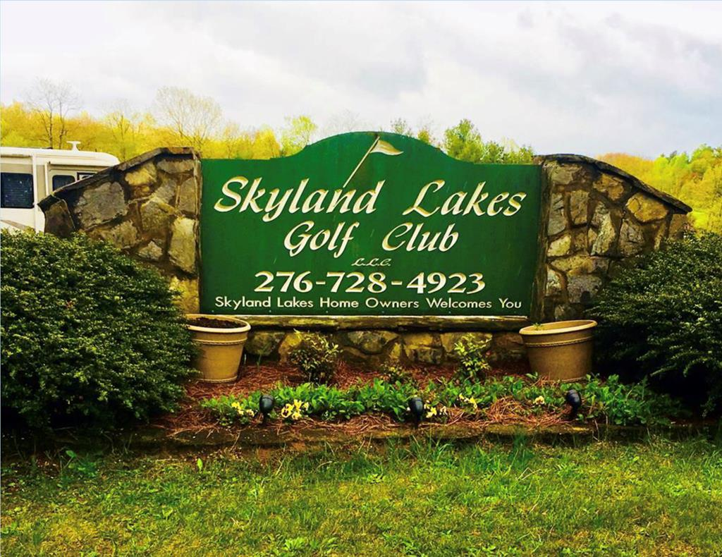 Just off the Blue Ridge Parkway, this buildable site sits across the street and overlooking the 9th fairway in Skyland Lakes Golf Resort. Its a level wooded lot, and perfect for building your dream home. Golf the greens, enjoy the clubhouse, or lounge around the lakes. Golf rates are discounted for residents. Check out current rates, and amenities, and the aerial in our additional photo section.. Only 3 miles to I-77 and Hwy. 52. Only 8 miles to the Blue Ridge Music Center, and 20 minutes to Mt. Airy, NC. The Golf Resort is right off of the Blue Ridge Parkway in the Blue Ridge Mountains. Near and easy to the Jefferson National Forest, the New River and the New River Trails.